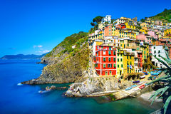 Riomaggiore village, rocks and sea at sunset. Cinque Terre, Ligu. Riomaggiore village on cliff rocks and sea at sunset., Seascape in Five lands, Cinque Terre Royalty Free Stock Image