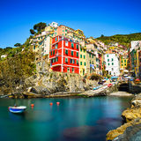 Riomaggiore village, rocks and sea at sunset. Cinque Terre, Ligu Royalty Free Stock Photos