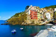 Riomaggiore village, rocks and sea at sunset. Cinque Terre, Ligu Stock Images