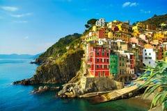 Riomaggiore village, rocks and sea at sunset. Cinque Terre, Ligu Royalty Free Stock Photos