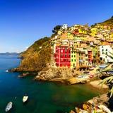 Riomaggiore village, rocks and sea at sunset. Cinque Terre, Ligu Stock Photography
