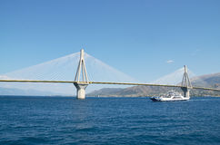 Rio-Antirrio bridge and ferry boat Royalty Free Stock Images