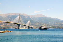 Rio- Antirrio bridge and ferry boat Stock Photo
