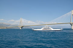 Rion-Antirion bridge and ferry boat Stock Images