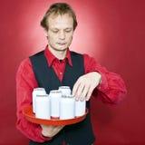 Riordinamento delle latte Immagini Stock