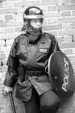 Riot Cop. Female British Police Officer in Riot equipment Stock Image