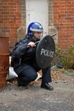 Riot Cop. Female British Police Officer in Riot equipment Royalty Free Stock Images