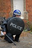 Riot Cop. Female British Police Officer in Riot equipment Stock Images