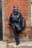 Riot Cop. Female British Police Officer in Riot equipment Stock Photography