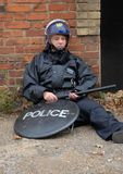 Riot Cop. Female British Police Officer in Riot equipment Royalty Free Stock Photography