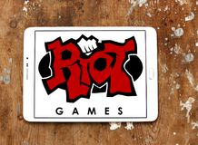 Riot Games company logo. Logo of Riot Games company on samsung tablet on wooden background. Riot Games is an American video game developer, publisher, and Royalty Free Stock Image
