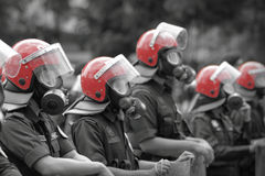 Riot Gear. Confronting a row of riot police in riot gear Royalty Free Stock Images