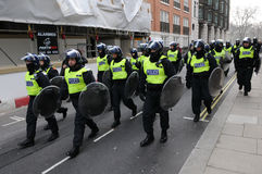 Riot Police Advance through Central London. Police in riot gear advance through central London after violent clashes during a large austerity rally on March 26 Royalty Free Stock Images