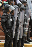 Riot police behind shields Royalty Free Stock Photos