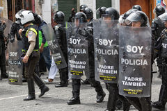 Riot police behind shields outdoors in Ecuador Royalty Free Stock Photography