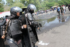 Riot police. Broke up a rally that anarchists in the city of Solo, Central Java, Indonesia Royalty Free Stock Images