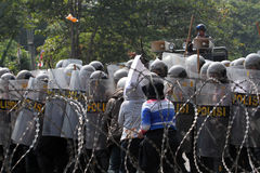 Riot police. Broke up a rally that anarchists in the city of Solo, Central Java, Indonesia Royalty Free Stock Photo