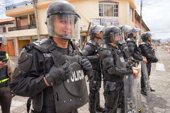 Riot police closeup. June 24, 2017 Cotacachi, Ecuador: riot police closing off access to a street at the Inti Raymi parade at summer solstice Stock Images