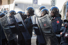 Riot police confronts protesters in Milan, Italy Stock Photo