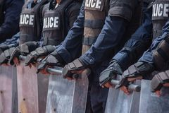 Riot police control the crowd. stock photo