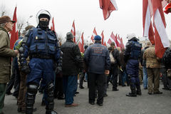 Riot police in crowd Royalty Free Stock Images