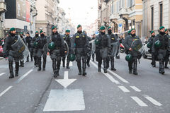 Riot police following Kurdish demonstrators in Milan, Italy Stock Photos