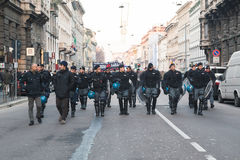 Riot police following Kurdish demonstrators in Milan, Italy Royalty Free Stock Image