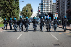 Riot police follows protesters in Milan, Italy Royalty Free Stock Photography