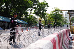Riot-police guarding Government House in Bangkok Royalty Free Stock Photo