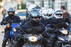 Riot police on motorcycles during a rally in front of the Athens University, which is under occupation by the protesters Stock Photos