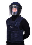 Riot police officer. A police officer dressed for public order and riot control duties. Helmet and body armour Stock Image