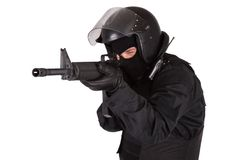 Riot police officer in black uniform Stock Images