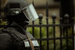 Riot police. Officer waiting in the rain Stock Image