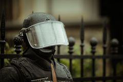 Riot police. Officer waiting in the rain Stock Photo