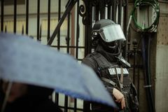 Riot police. Officer waiting in the rain Royalty Free Stock Photos