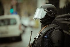 Riot police. Officer waiting in the rain Stock Images