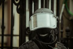 Riot police. Officer waiting in the rain Royalty Free Stock Photography