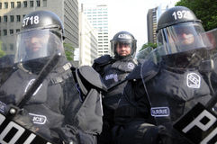 Riot police officers blocking the downtown streets. TORONTO-JUNE 25: Police in Riot gear during the G20 Protest on June 25, 2010 in Toronto, Canada Royalty Free Stock Photo