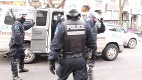 Riot police officers in full gear exit police van stock video footage