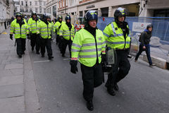 Riot Police at a Protest in London. Police in riot gear advance through central London during a large anti-cuts rally on March 26, 2011 in London, UK Stock Image