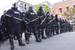 Riot police ready to march. SAN DIEGO, USA - MAY 27, 2016: Riot police in full tactical gear stand ready to confront protesters at a Trump rally at the San Diego Royalty Free Stock Photos