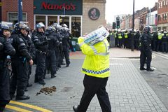 Riot police receiving water Royalty Free Stock Photos