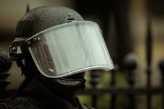 Riot police. Officer waiting in the rain Stock Photography