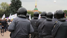 Riot police row watching passing meeting, Russia Stock Photo