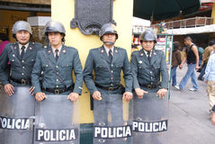 Riot police with shields Stock Photography