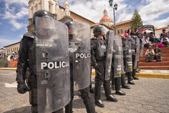 Riot police with shields. June 24, 2017 Cotacachi, Ecuador: riot police closing off access to a street at the Inti Raymi parade at summer solstice Stock Photos