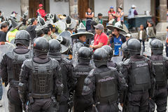 Riot police with shields standing in the street Royalty Free Stock Photo