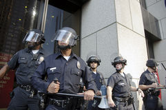 Riot police stand guard during Occupy LA march Royalty Free Stock Images