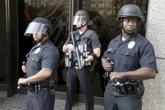 Riot police stand guard during Occupy LA march Royalty Free Stock Image