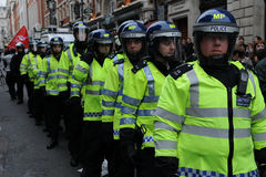 Riot Police on Standby at an Austerity Protest. Police in riot gear on standby at Piccadilly Circus in central London after voilent clashes during a large Stock Image